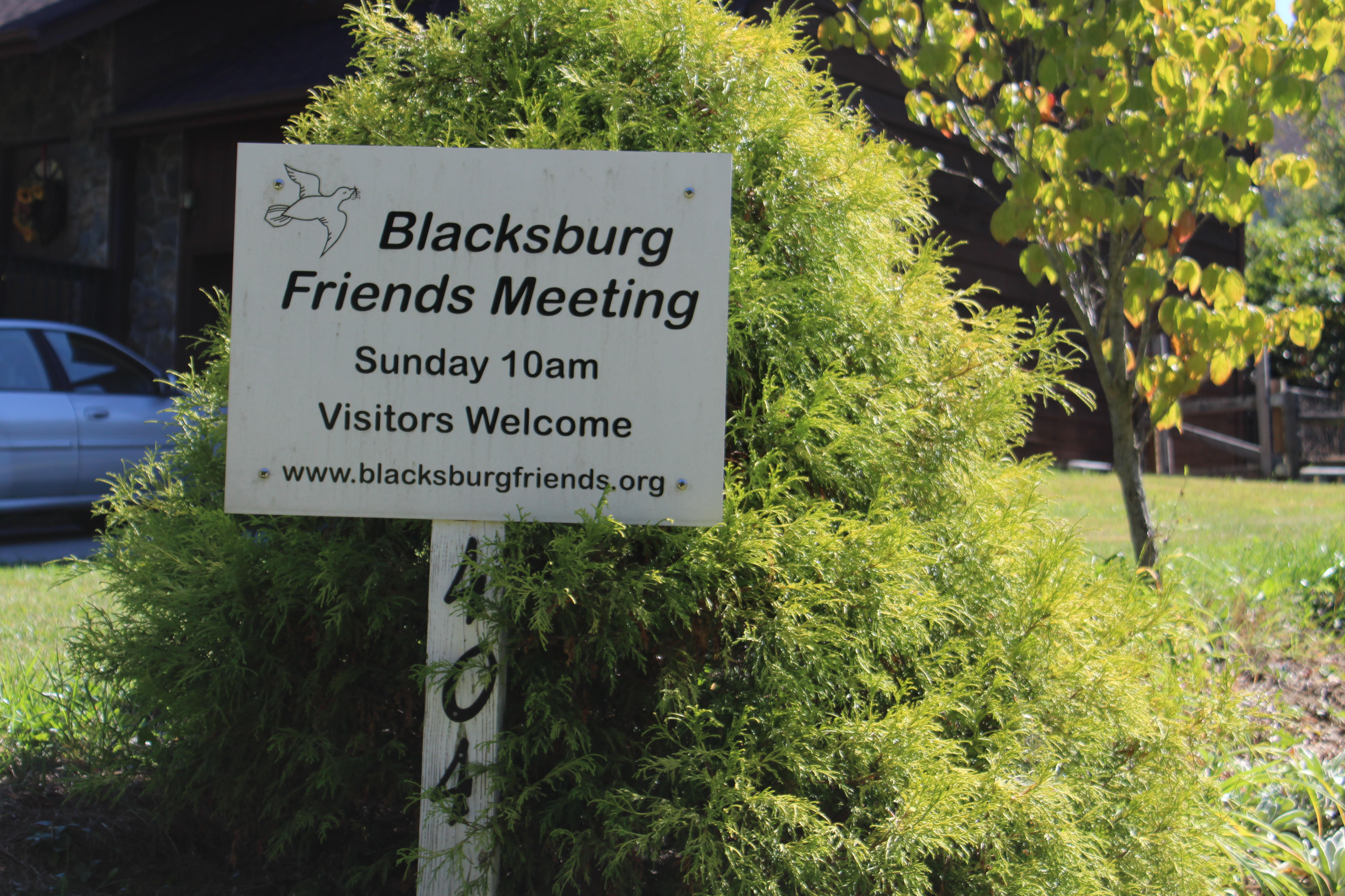 Driveway sign for Blacksburg Friends Meeting. Sunday 10am, Visitors Welcome